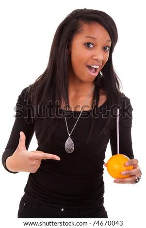 young black woman drinking orange juice - stock photo