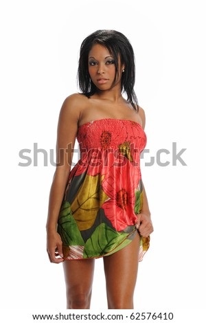 Young black woman jumping wearing a colorful dress isolated on a white background - stock photo