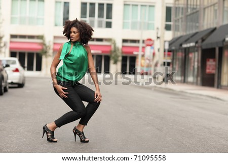 Young black woman posing in the middle of the street - stock photo