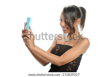 Young black woman taking a selfie isolated on a white background - stock photo