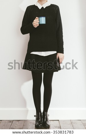 young blogger posing with black skirt and sweater - stock photo