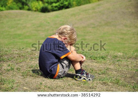 Young blond boy desperation body language - stock photo