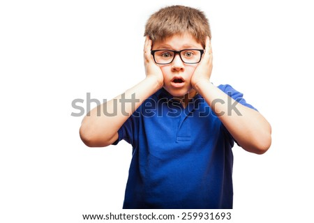 Young blond boy looking shocked and surprised in a white background - stock photo