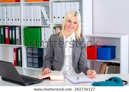 young blond business woman in the office - stock photo