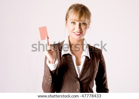 young blond business woman with a businesscard - stock photo