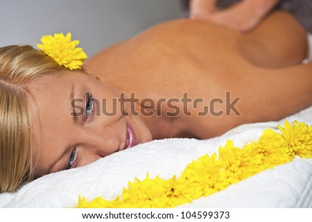 Young blond caucasian woman receiving back massage at Beauty Spa salon. Horizontal - stock photo