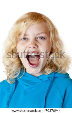 Young blond girl screams loudly at camera. Isolated on white background. - stock photo