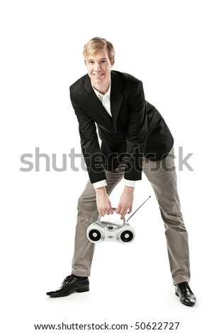 Young blond handsome man with a boombox; isolated on white - stock photo