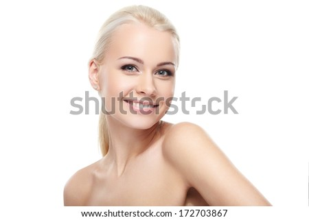 Young blond lady with a beautiful smile on white background - stock photo
