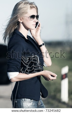 Young blond on the phone - stock photo