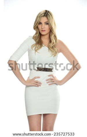 Young blond wearing a white dress posing - stock photo