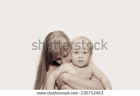 Young blond woman and child filtered sepia - stock photo