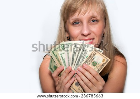 young blond woman counts money dollars isolated smile - stock photo