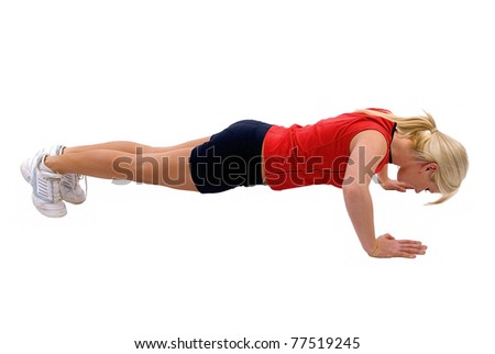 Young blond woman doing push ups - stock photo