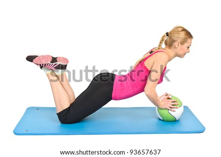 Young blond woman doing pushups on medicine ball, lower position - stock photo