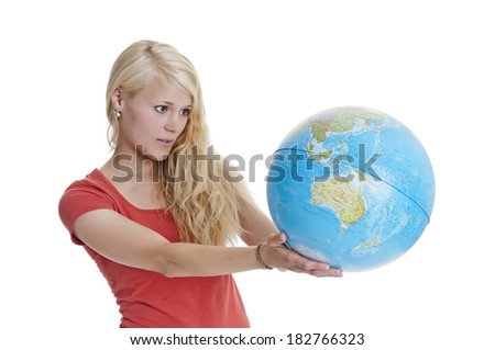 young blond woman holding globe - stock photo