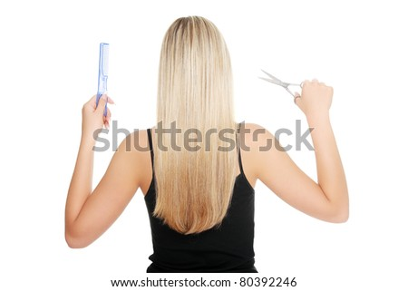 Young blond woman holding hairdresser's tools , isolated on white - stock photo