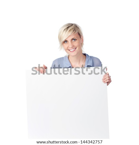 Young blond woman holding white sign against white background - stock photo