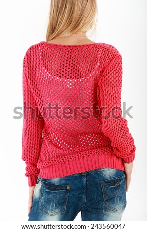 Young blond woman in red net sweater and jeans closeup from the back isolated  - stock photo
