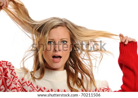 Young Blond Woman pulling her hair isolated on a white background - stock photo