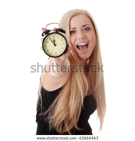 Young blond woman showing alarm clock, isolated on white - stock photo
