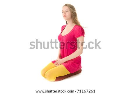 Young blond woman sitting on the floor isolated on white - stock photo