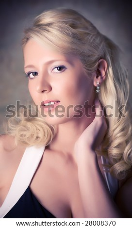 Young blond woman soft portrait. - stock photo
