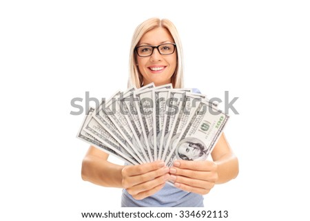 Young blond woman spreading a stack of money and showing it to the camera isolated on white background - stock photo