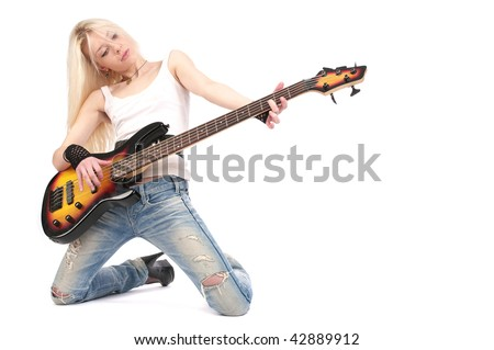 Young blond woman stay on knees and play on the guitar, isolated on the white background. - stock photo
