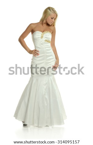 Young Blond woman wearing a gown isolated on a white background - stock photo