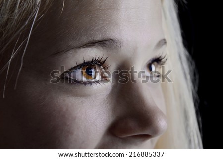 young blond woman with beautiful eyes - stock photo
