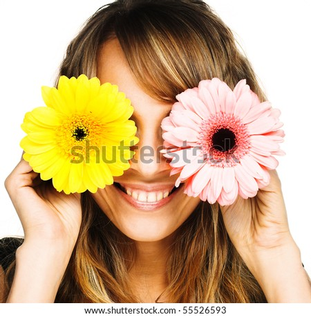 Young blond woman with flowers in her hands - stock photo