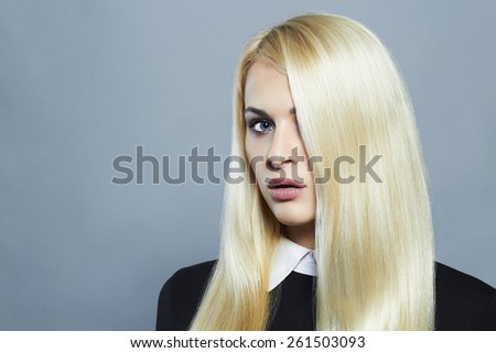 Young blond woman with healthy hair.Beautiful Girl in schoolgirl uniform.Fashion portrait - stock photo