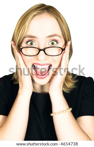 Young blond woman with large green eyes in glasses holding her head in her hands and screaming with joy - stock photo