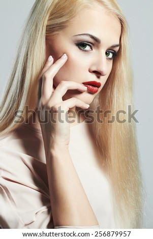 Young Blond woman with manicure.Beautiful girl model with make-up - stock photo