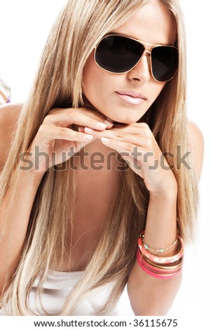 young blond woman with sunglases, studio white - stock photo