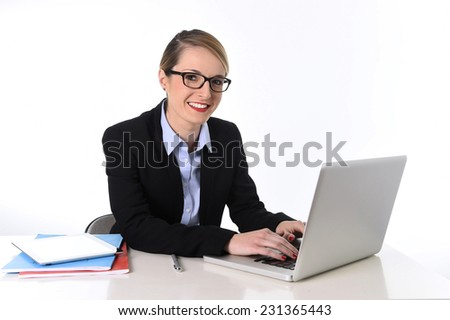 young blonde attractive business woman at office working happy with computer in suit and glasses smiling in success at work and efficiency concept isolated on white background - stock photo