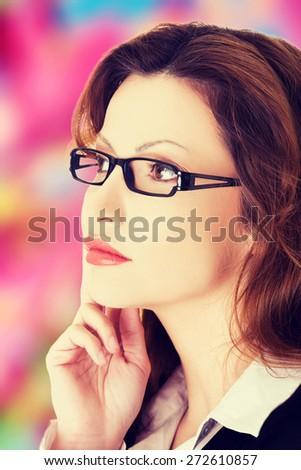 Young blonde beautiful businesswoman thinking - stock photo