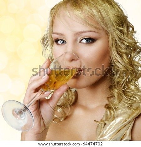 Young blonde beautiful woman with champagne glass - stock photo