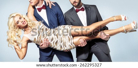 Young blonde beauty and two handsome men - stock photo