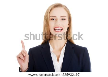Young blonde businesswoman explaining something - stock photo