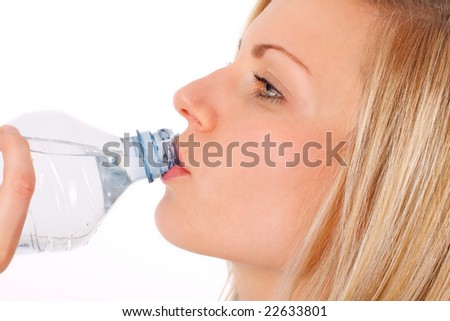 young blonde female drinking water from a bottle - stock photo