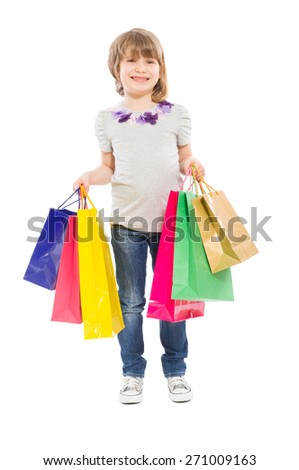 Young blonde girl holding shopping bags isolated on white background - stock photo