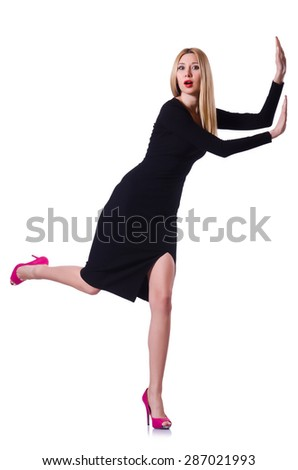 Young blonde girl in black dress pushing isolated on white - stock photo
