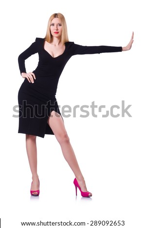 Young blonde girl in black pushing isolated on white - stock photo