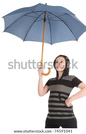 Young blonde girl standing and holding blue umbrella - stock photo