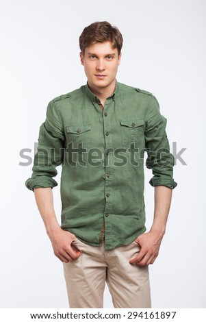 young blonde man with green shirt posing, isolated on white - stock photo