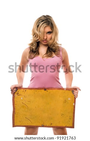 Young blonde posing with yellow vintage board - stock photo
