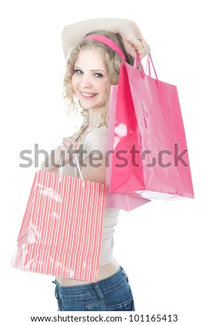 Young blonde teenage girl with pink shopping bags over white - stock photo