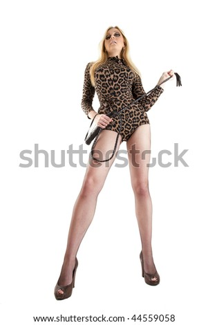 young blonde with whip posing over white, wide angle shot - stock photo